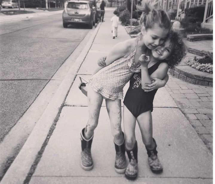 The photographer's daughters, in an impromptu muddy cuddle, snapped on a cellphone.