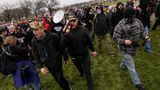 FILE - In this Wednesday, Jan. 6, 2021 file photo Ethan Nordean, with backward baseball hat and bullhorn, leads members of the far-right group Proud Boys in marching before the riot at the U.S. Capitol. Nordean, 30, of Auburn, Washington, has described himself as the sergeant-at-arms of the Seattle chapter of the Proud Boys. The Justice Department has charged him in U.S. District Court in Washington, D.C., with obstructing an official proceeding, aiding and abetting others who damaged federal property, and knowingly entering or remaining in a restricted building. He asked a judge Monday, Feb. 8, 2021, to release him from detention pending trial. (AP Photo/Carolyn Kaster,File)