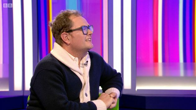 Alan Carr listens politely while being thanked for his work in the world of interior
