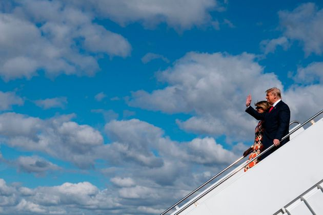 Donald Trump and Melania Trump step off Air Force One as they arrive at Palm Beach International Airport...