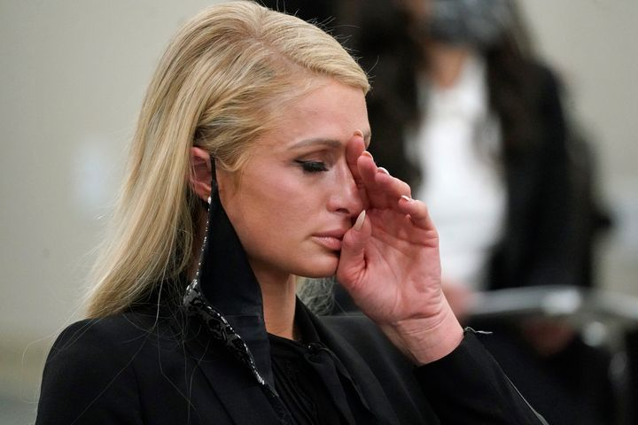 Paris Hilton wipes her eyes after speaking at a committee hearing at the Utah State Capitol, Monday, Feb. 8, 2021, in Salt La