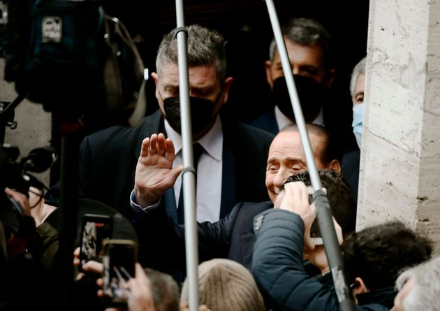 Leader of the right-wing party Forza Italia, Silvio Berlusconi (R) waves to the media on February 9,...