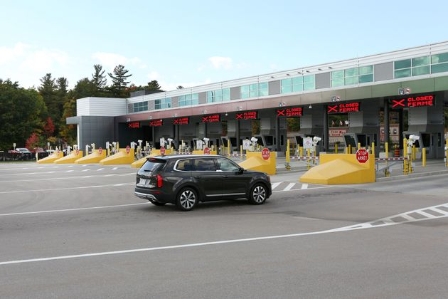 A car enters the Canadian checkpoint at the Canada-United States border crossing at the Thousand Islands...