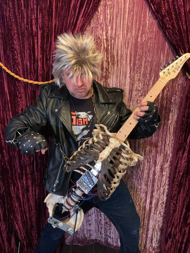Florida-based musician Prince Midnight shows off his guitar made from his Uncle Filip's