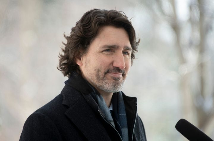 Prime Minister Justin Trudeau listens to a reporters question outside Rideau Cottage Ottawa on Feb. 9, 2021.