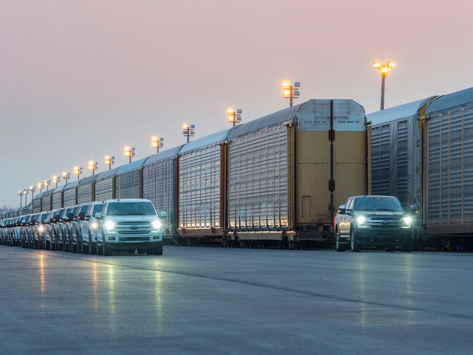 Ford demonstrated its battery-powered F-150 truck's strength by successfully towing more than 1.25 million pounds of rail car