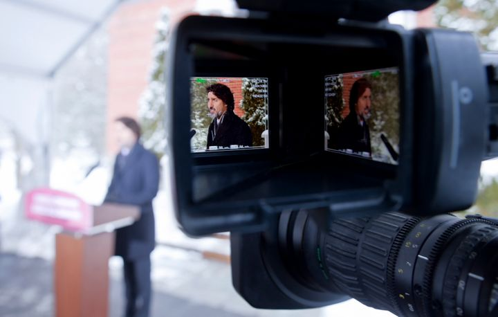 Two images of Prime Minister Justin Trudeau are seen in the viewfinder of a TV camera as he holds a news conference at  Rideau Cottage in Ottawa on Feb. 5, 2021.