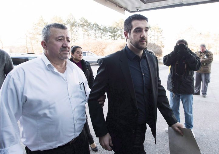 Marco Muzzo, right, arrives with family for his sentencing hearing in Newmarket, Ont., on Feb. 23, 2016.