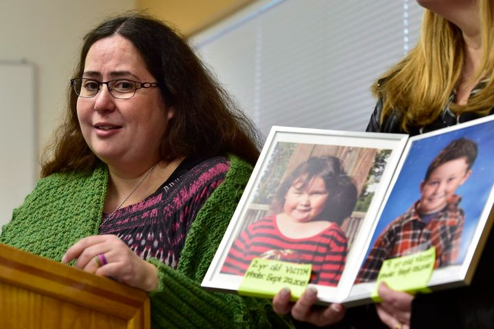 Jennifer Neville-Lake speaks as a supporter holds a photo of her late daughter Milly, left, and son Daniel, during a press conference following Marco Muzzo's parole hearing on Nov. 7, 2018.  A panel with the Parole Board of Canada says Muzzo has not addressed his alcohol misuse, and denied him both day parole and full parole.