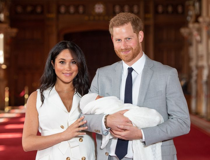 The Duke and Duchess of Sussex pose with their newborn son, Archie Harrison Mountbatten-Windsor, during a photocall in St George's Hall at Windsor Castle on May 8, 2019.