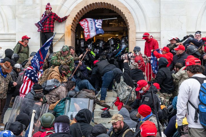 Pro-Trump insurrectionists attack police officers protecting an entrance to the U.S. Capitol on Jan. 6, 2021.