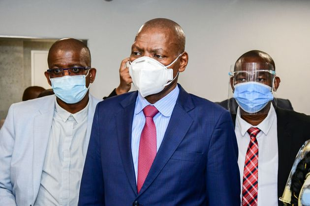 South African Health Minister Zweli Mkhize, centre, inspects a health-care facility in Durban, South...