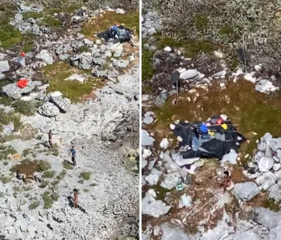 The three people are seen in photos taken by the U.S. Coast Guard on Monday. Food, water and other supplies were dropped down