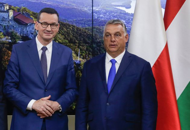 Picture taken on September 24, 2020 shows Polish Prime Minister Mateusz Morawiecki (L) and Hungarian...