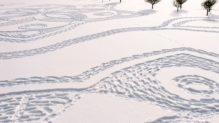 Part of a giant complex geometric pattern formed from thousands of footsteps in the snow in Espoo, Finland, Monday Feb. 8, 20