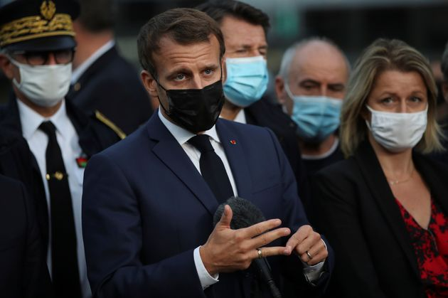 French President Emmanuel Macron delivers his speech next to Environment Minister Barbara Pompili in...
