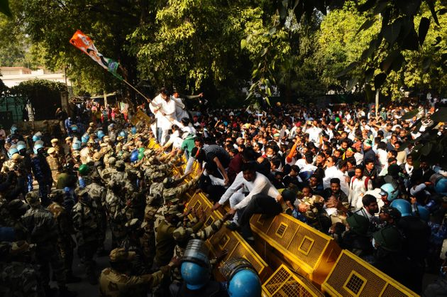 Protesters broke down barricades and clashed with police in New Delhi on Feb. 09,