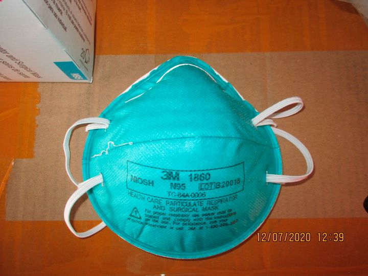 This December 2020 image provided by U.S. Immigration and Customs Enforcement (ICE) shows a counterfeit N95 surgical mask tha