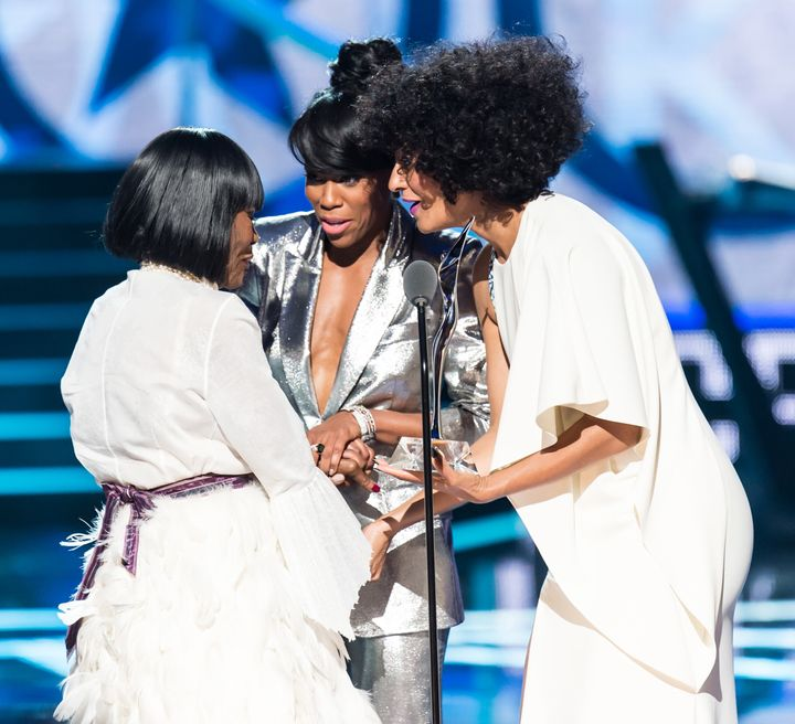 "Tyson, left, with hosts Regina King (center) and Tracee Ellis Ross (right) during the 2015 BET special ""Black Girls Rock!""&nbsp;<i>Gilbert Carrasquillo via Getty Images</i>"
