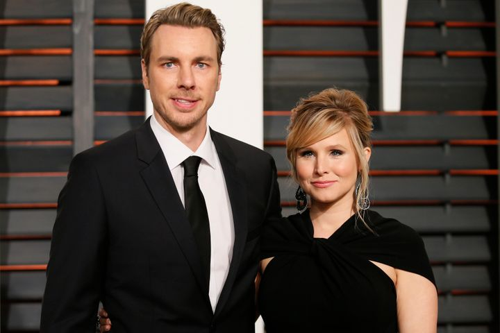 Kristen Bell and husband Dax Shepard arrive at the Vanity Fair Oscar Party in Beverly Hills, California, on Feb. 22, 2015.