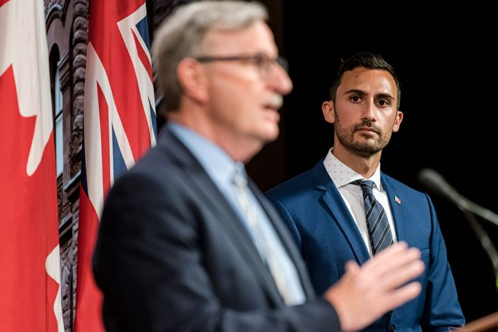 Dr. David Williams, Ontario's chief medical officer of health and Education Minister Stephen Lecce make an announcement at Queen's Park in Toronto, on Aug, 13, 2020.