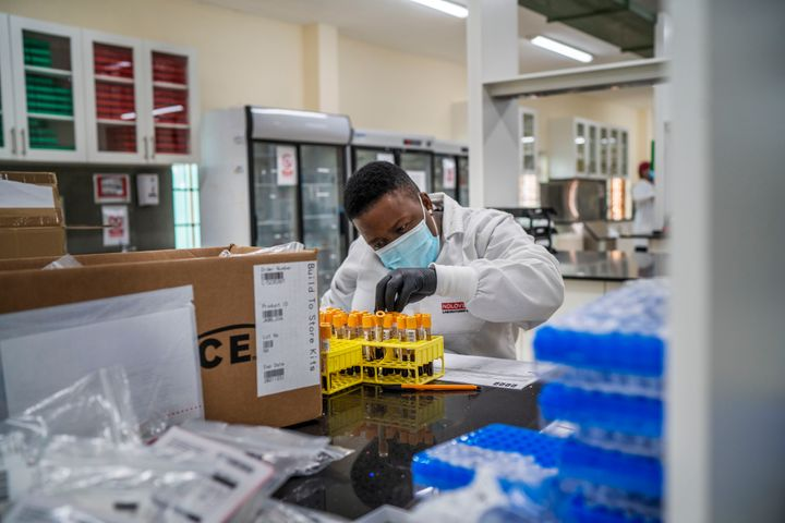 A lab technician works on blood samples taken from people taking part in a Johnson & Johnson Covid-19 vaccine test at the Ndlovu clinic's lab in Groblersdal, South Africa on Feb. 11, 2021.