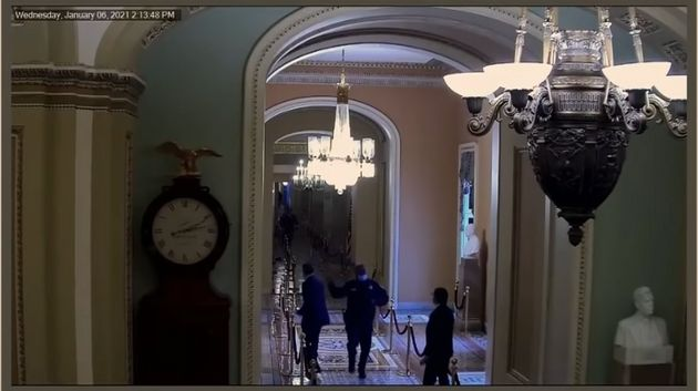 Senator Mitt Romney (left) and US Capitol Police officer Eugene Goodman seen in security camera
