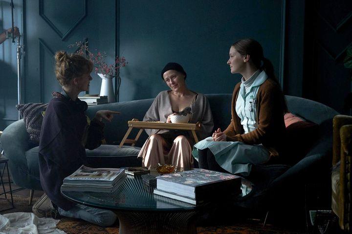 "Rose Glass, Jennifer Ehle and Clark on the set of ""Saint Maud."""