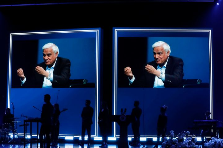 In this May 29, 2020 file photo, images of Ravi Zacharias are displayed in the Passion City Church during a memorial service