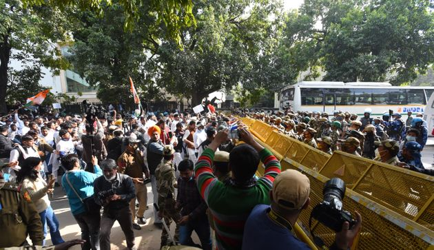 Protesters broke down barricades and clashed with police in New Delhi on February 9,