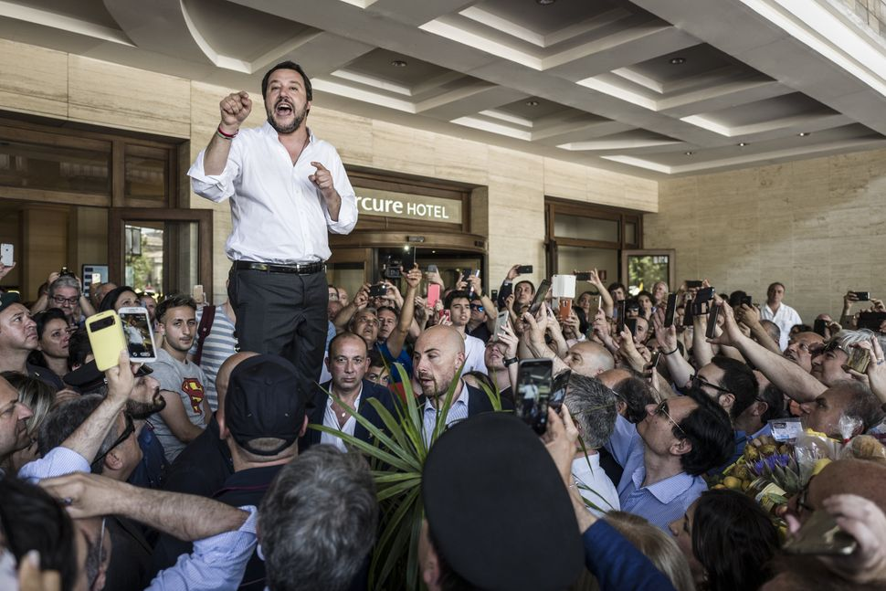 Then-new interior minister Matteo Salvini rallies his supporters at the Sicilian port city of Catania on June 3, 2018, t