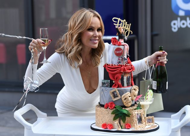 Amanda Holden posing with a special cake in honour of her