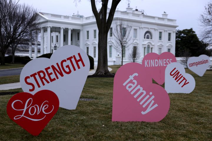 Heart-shaped signs with Valentine messages on the North Lawn of the White House on Feb. 12, 2021, in Washington, D.C.