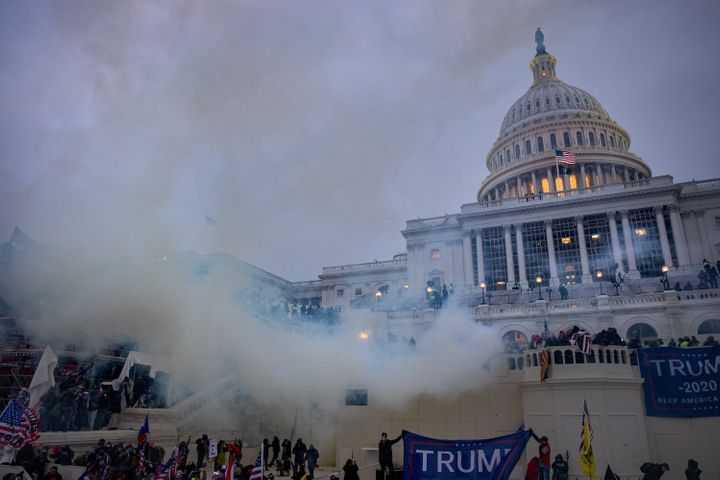 Tear gas wafts across the grounds of the U.S. Capitol during the siege of the building by supporters of then-President Donald