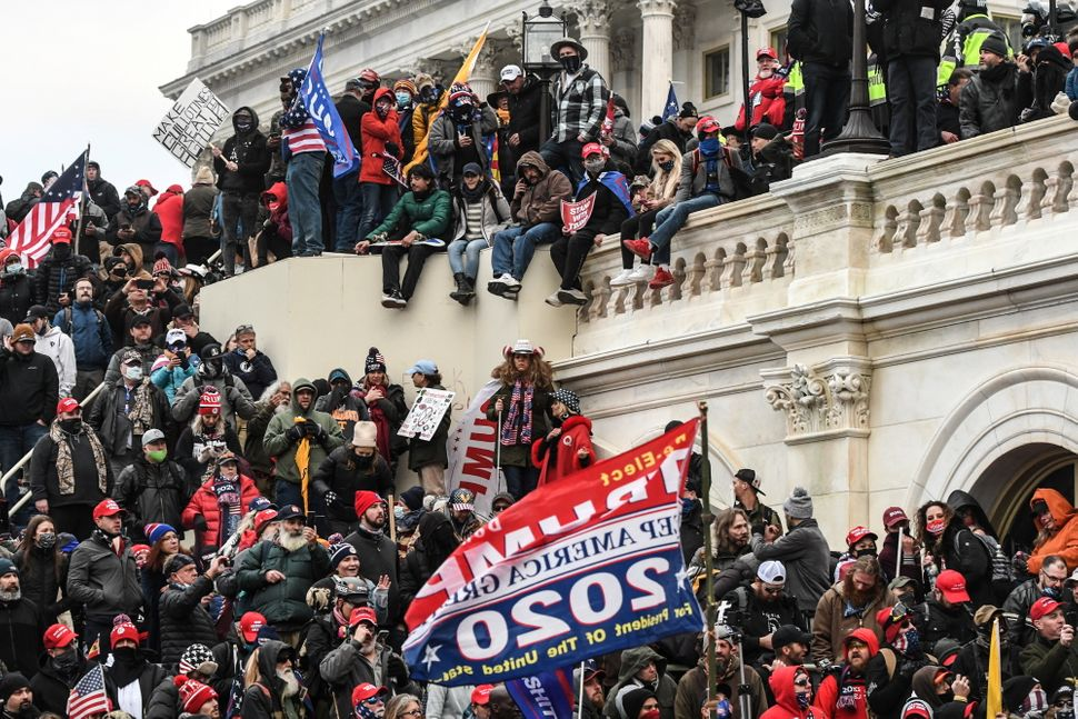 Supporters of President Donald Trump gather at the west entrance of the U.S. Capitol on Jan. 6 after busting through barriers