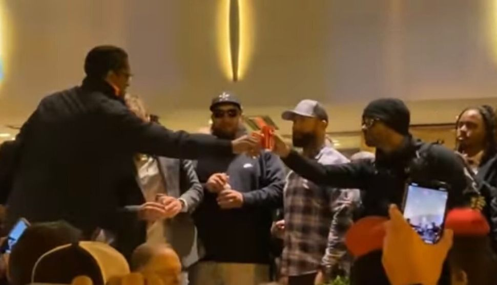 Ali Alexander and Proud Boys leader Enrique Tarrio toast in November 2020, after a Stop the Steal rally in Washington.