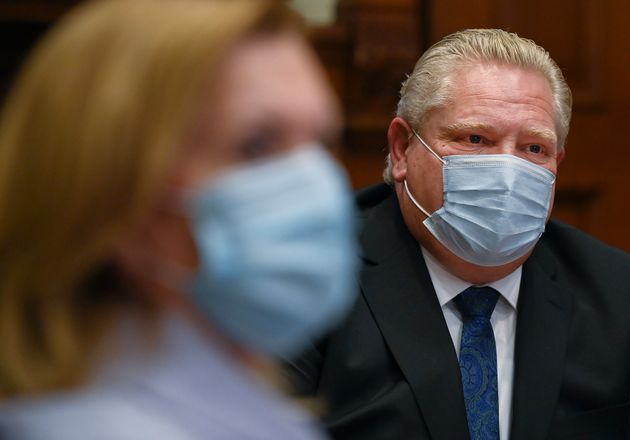 Ontario Premier Doug Ford, right, gives an update regarding the Ontario COVID-19 vaccine during the COVID-19...