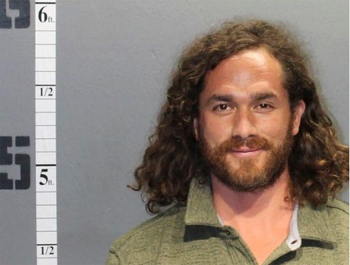 Authorities say Eduardo Nicolas Alvear Gonzalez, pictured, was seen wearing American flag pants and allegedly smoking marijua