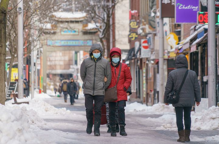 A couple walks in Chinatown during the COVID-19 pandemic in Montreal, on Monday, January 18, 2021.