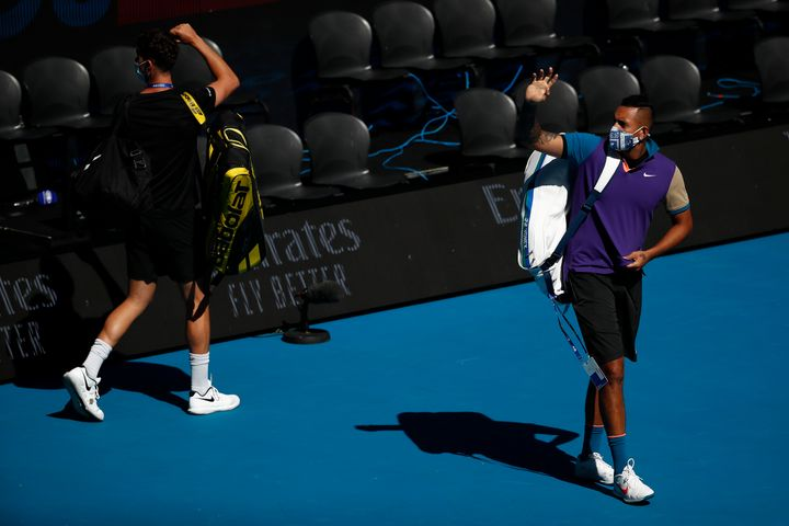 Nick Kyrgios and Thanasi Kokkinakis walk onto Margaret Court Arena ahead of their Men's Doubles second round match during day seven of the 2021 Australian Open.