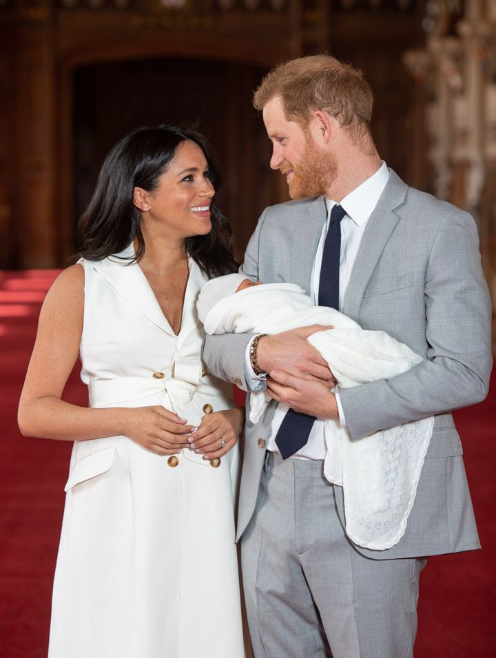Meghan Markle and Prince Harry pose with their two-day-old son Archie Harrison Mountbatten-Windsor on May 8, 2019.