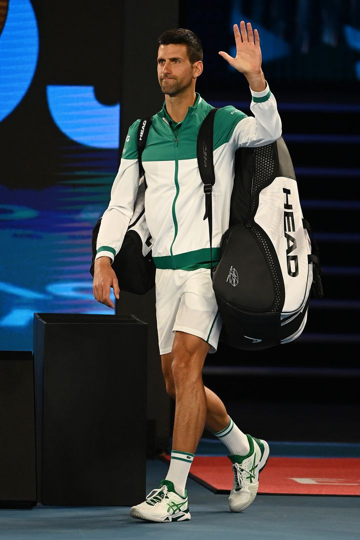 Novak Djokovic walks onto the court in his Men's Singles third round match during day five of the 2021 Australian Open at Melbourne Park on February 12, 2021 in Melbourne, Australia.