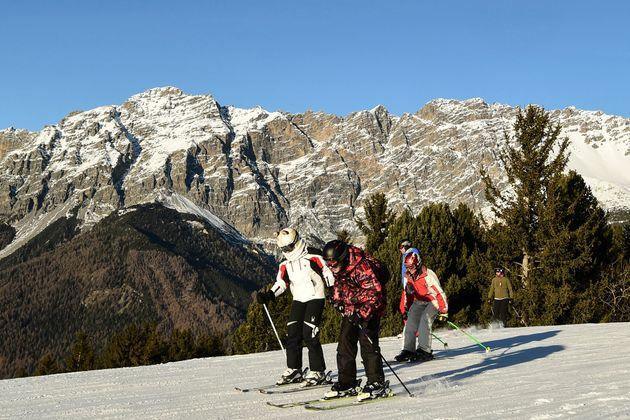 Skiers in Bormio, in the Italian Alps, in December