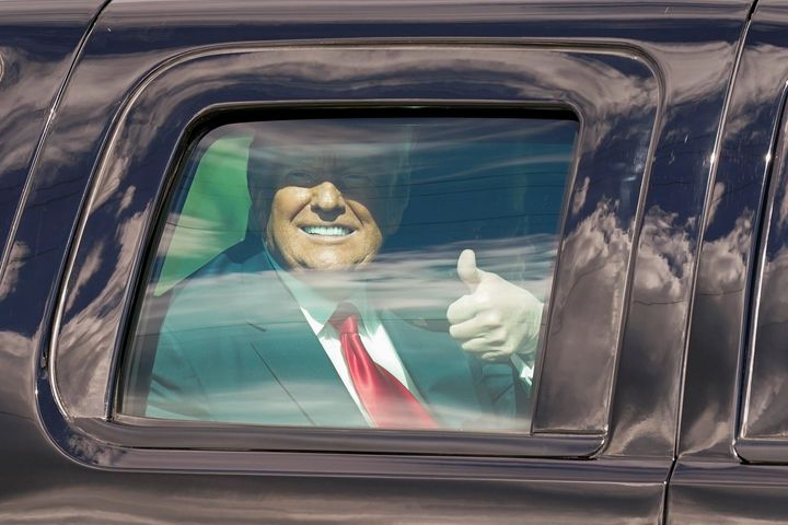 President Donald Trump gestures to supporters en route to his Mar-a-Lago Florida Resort on Jan. 20, 2021, in West Palm Beach,