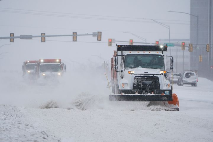Snowplows works to clear the road during a winter storm Sunday, Feb. 14, 2021, in Oklahoma City. (AP Photo/Sue Ogrocki)
