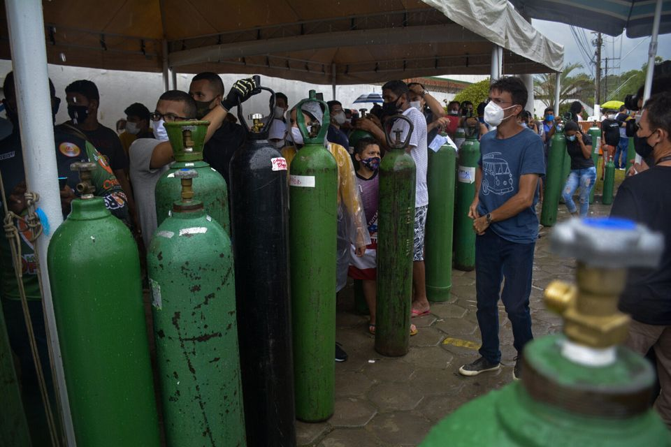Relatives of patients infected with Covid-19 queue for long hours to refill their oxygen tanks in Manaus,
