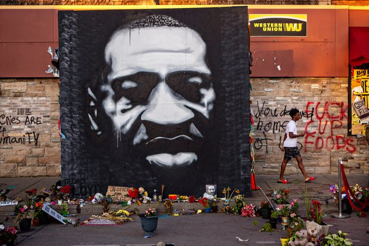 MINNEAPOLIS, MN - JULY 26: A large black and white mural of George Floyds face stands tall on the sidewalk outside of Cup Foo