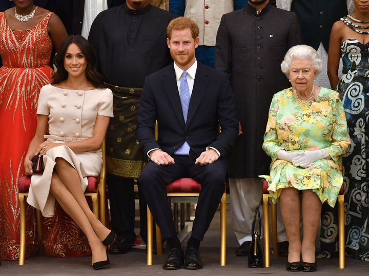 The Duke and Duchess of Sussex and Queen Elizabeth II at the Queen's Young Leaders Awards Ceremony at Buckingham Palace on Ju