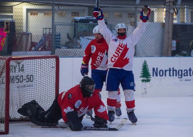 Goalie Andrew Buchanan is scored on as Justin Christopher celebrates during the World's Longest Hockey...