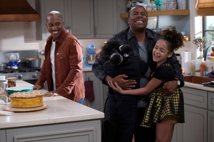 "In a scene from ""Kenan,"" child actors Dani and Dannah Lane hug Kenan Thompson as Chris Redd looks on."